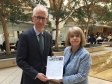 Lloyd's Bank's Benedict Brogan receives the Upton petition from Harriett Baldwin MP