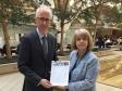 Lloyd's Bank's Benedict Brogan receives the Upton petition from Harriett Baldwin MP