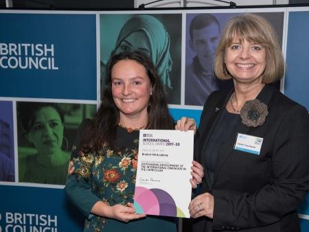 Harriett Baldwin presents the International School Award to Bredon Hill Academy's Anne Amzallag