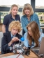 'Brilliant Brains' event: James Bower and Rebecca Hitchings show their project to QinetiQ's Tara Francis and Harriett Baldwin MP