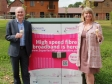 Simon Geraghty and Harriett Baldwin MP have a 99 ice cream to celebrate 99% superfast broadband coverage for Malvern