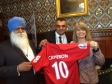 Photo shows shirt presented to Harriett Baldwin MP by Makhan Singh Padda (left) and Bal Padda for the Prime Minister