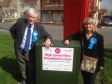 Parliamentary Candidate Harriett Baldwin and county councillor Ken Pollock celebrate the new upgraded broadband cabinet.