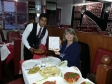 Harriett Baldwin MP samples food at the Upton's Flava Fusion restaurant