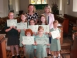 Harriett Baldwin presents awards at Grimey and Holt Primary School's weekly prize-giving