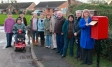 Harriett Baldwin MP helps to celebrate post box return