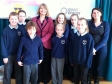 Harrriett poses with Pendock Primary's school council together with Kate Turner from Good Energy