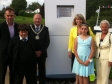 Harriett unveils a plaque at Upton flood defences